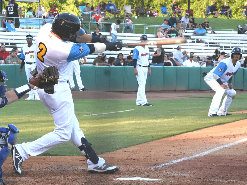 The Missions' Jake Hager hits a pinch-hit home run with Jacob Nottingham on base in the first game of Thursday's doubleheader against the Dodgers at Wolff Stadium. - photo by Joe Alexander