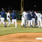 The Missions surround Mauricio Dubon after his winning hit in the Missions' 6-5 victory over the Redbirds on Tuesday at Wolff Stadium. - photo by Joe Alexander