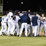The Missions celebrate in the middle of the field after their 6-5 victory over the Redbirds on Tuesday at Wolff Stadium. - photo by Joe Alexander