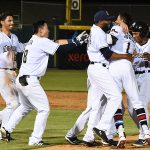 The Missions mob teammate Mauricio Dubon after he drove in the winning run in the Missions' 6-5 victory over the Memphis Redbirds on Wednesday at Wolff Stadium. - photo by Joe Alexander