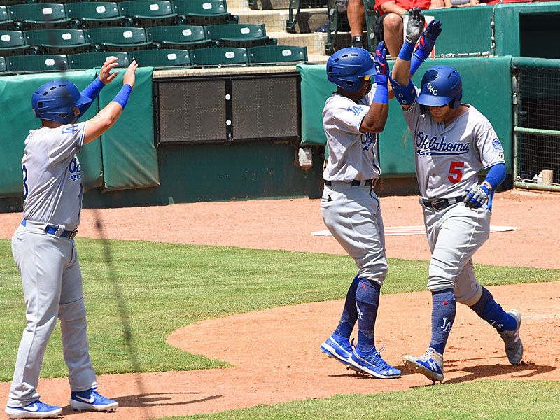 Oklahoma City's Matt Beaty (right) is greeted at the plate after hitting a third-inning home run against San Antonio on Sunday at Wolff Stadium. - photo by Joe Alexander