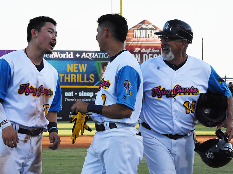 Missions manager Rick Sweet with San Antonio players Keston Hiura (left) and Mauricio Dubon (center) on Saturday at Wolff Stadium. - photo by Joe Alexander
