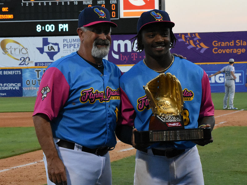 The Missions' Troy Stokes Jr. is joined by Missions manager Rick Sweet at Stokes receives his Gold Glove award Thursday at Wolff Stadium. - photo by Joe Alexander