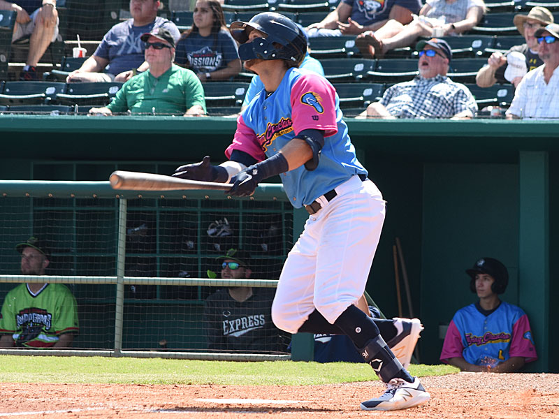 The Missions' Jake Hager drills a game-ending single to center against the Round Rock Express on Sunday at Wolff Stadium. - photo by Joe Alexander