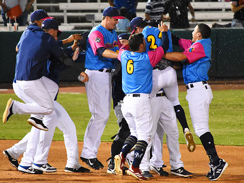 The Missions celebrate after Tyler Saladino's walk-off double against the Redbirds on Thursday at Wolff Stadium. - photo by Joe Alexander