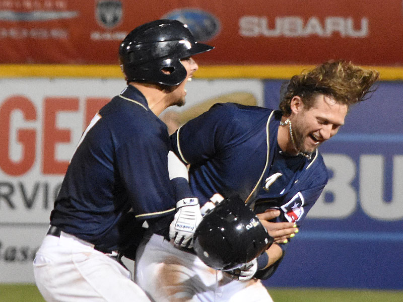 The San Antonio Missions' Jake Hager (right) and Jacob Nottingham celebrate after Hager's walk-off hit against the New Orleans Baby Cakes on Tuesday at Wolff Stadium - photo by Joe Alexander