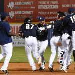 Jake Hager and his San Antonio Missions teammates celebrate after Hager's walk-off hit in the 10th inning against the New Orleans Baby Cakes on Tuesday at Wolff Stadium. - photo by Joe Alexander