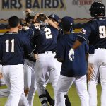 Jake Hager (2) and his San Antonio Missions teammates celebrate after Hager's walk-off hit in the 10th inning against the New Orleans Baby Cakes on Tuesday at Wolff Stadium. - photo by Joe Alexander