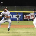 The San Antonio Missions' Cory Spangenberg (right) advances to third on a bunt fielded by New Orleans Baby Cakes pitcher R.J. Alvarez on Tuesday at Wolff Stadium. - photo by Joe Alexander