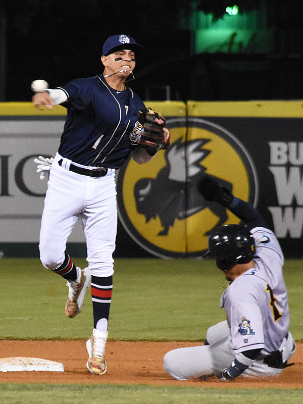 San Antonio Missions shortstop Mauricio Dubon turns a double play that ended the top of the 10th inning and kept the game scoreless on Tuesday at Wolff Stadium. - photo by Joe Alexander