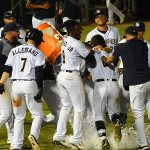 Nate Orf celebrates with Missions teammates after his walk-off sacrifice fly in the 12th inning on Saturday at Wolff Stadium. - photo by Joe Alexander