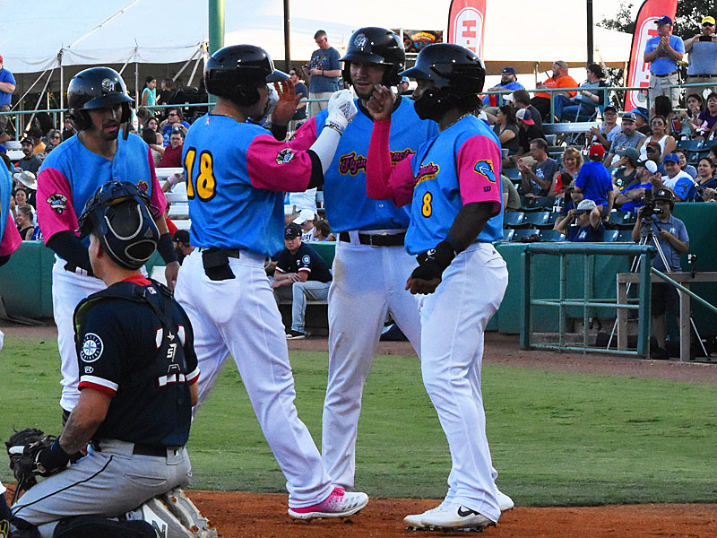 Keston Hiura celebrates with his teammates at the plate after hitting a grand slam in the second inning on Thursday at Wolff Stadium. - photo by Joe Alexander