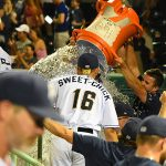 Missions players dump ice-water on manager Rick Sweet in the dugout after Tuesday's victory gave him 2,000 for his career. - photo by Joe Alexander