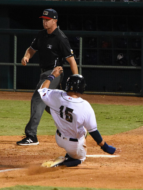 The Missions' Tyrone Taylor slides into home with the final run of the game on Tuesday at Wolff Stadium. - photo by Joe Alexander