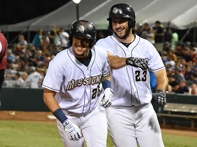 Hernan Perez (left) and David Freitas celebrate after Perez's fifth-inning home run. The San Antonio Missions to beat the Sacramento River Cats 8-4 Tuesday at Wolff Stadium. - photo by Joe Alexander