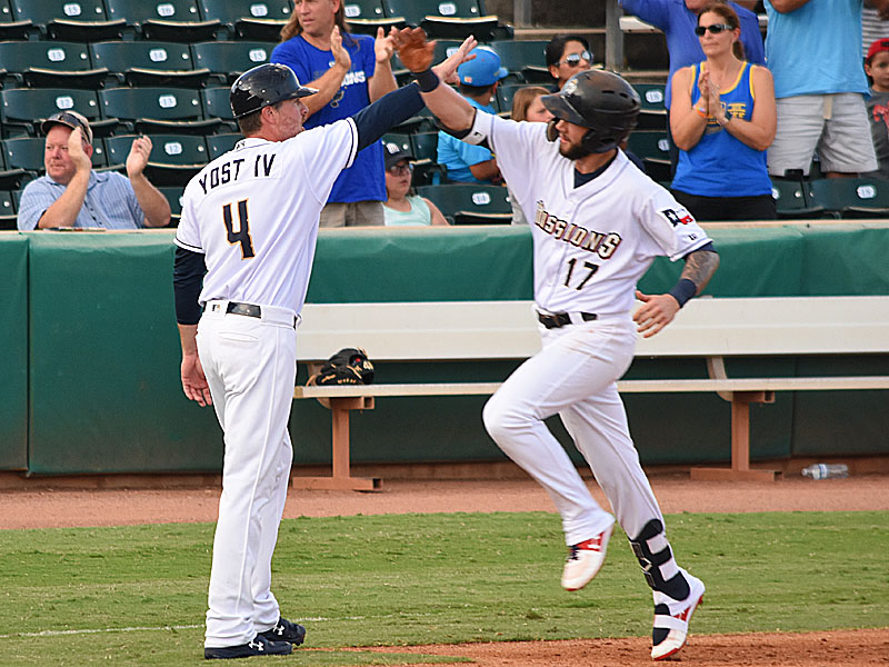 The Missions' Lucas Erceg celebrates his second-inning home run with third base coach Ned Yoast IV on Saturday at Wolff Stadium. - photo by Joe Alexander
