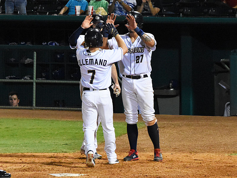 The Missions' Blake Allemand is congratulated at home plate by Jacob Nottingham (right) and Cory Spangenberg after Allemand's eighth-inning home run on Saturday at Wolff Stadium. - photo by Joe Alexander