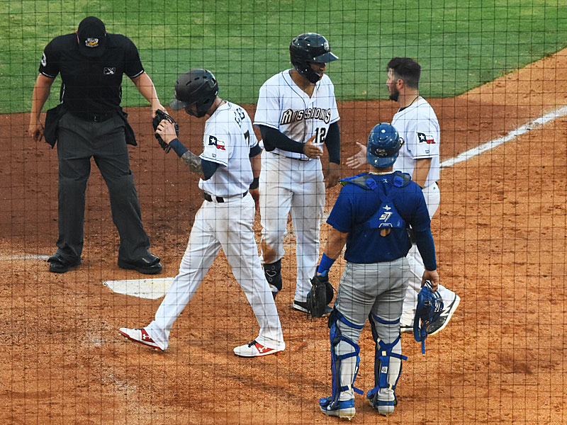 The Missions' Trent Grisham (12) is congratulated by Blake Allemand (right) and Lucas Erceg after hitting a fourth-inning home run Sunday at Wolff Stadium. - photo by Joe Alexander