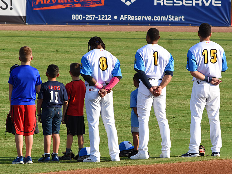 Missions outfielders Troy Stokes Jr. (8), Corey Ray (1) and Tyrone Taylor (15) stand for the National Anthem before Thursday's game at Wolff Stadium. - photo by Joe Alexander