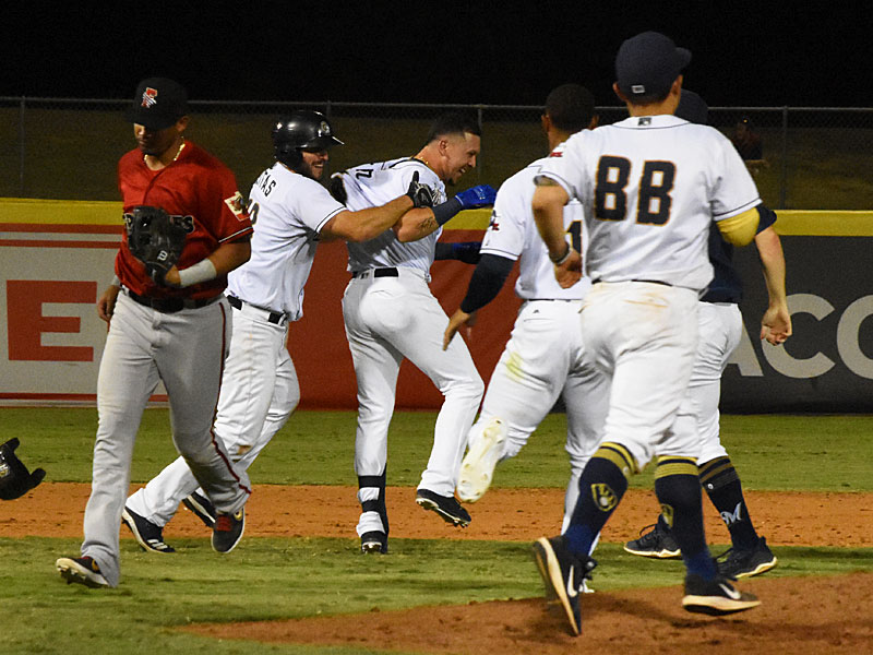 The Missions celebrate after Hernan Perez's walk-off hit in the 12th inning Saturday night at Wolff Stadium. - photo by Joe Alexander