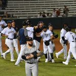 The Missions celebrate after Blake Allemand drove in Jacob Nottingham with the winning run in the 10th inning Friday at Wolff Stadium. - photo by Joe Alexander