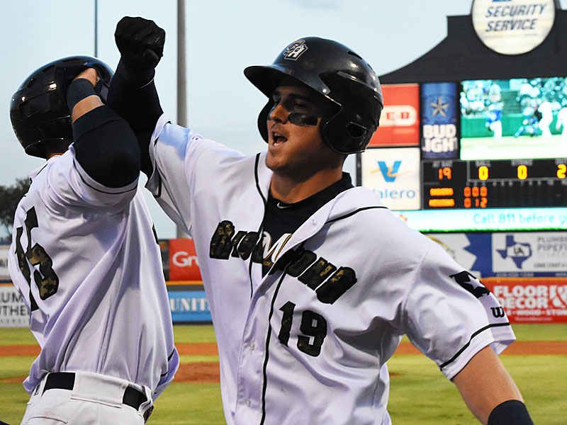 The San Antonio Missions' Tyler Austin (right) and Tyrone Taylor celebrate after Austin's two-run homer in the third inning on Friday at Wolff Stadium. - photo by Joe Alexander