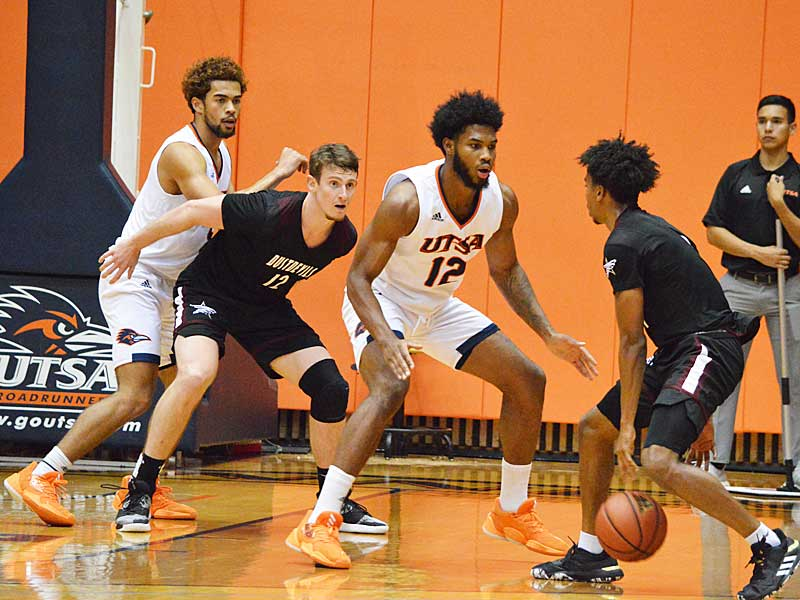 UTSA's Makani Whiteside (far left) and Phoenix Ford (12). The Roadrunners beat Texas A&M International 89-60 in an exhibition game on Wednesday, Oct. 30. 2019 at the UTSA Convocation Center. - photo by Joe Alexander