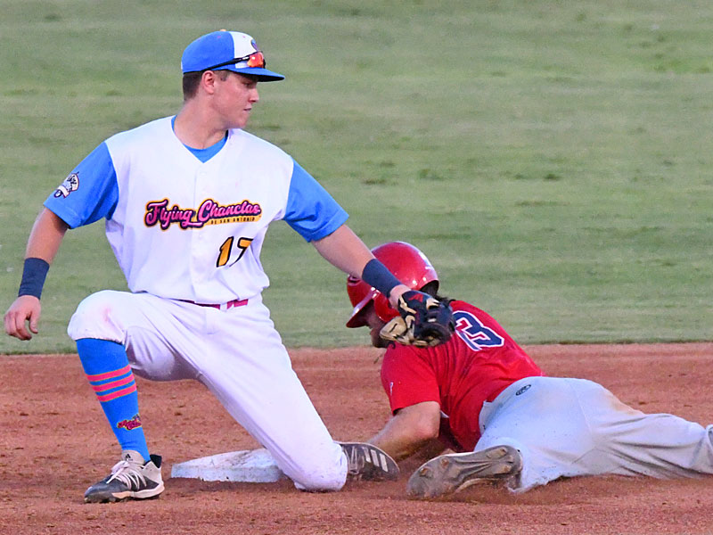 Chanclas shortstop Grant Smith tries to put a tag on the Cane Cutters' Marshall Skinner at second base on Sunday at Wolff Stadium. - photo by Joe Alexander