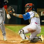 Flying Chanclas catcher Tyler LaRue tags out a Hairy Men runner at the plate on Friday night at Wolff Stadium. - photo by Joe Alexander