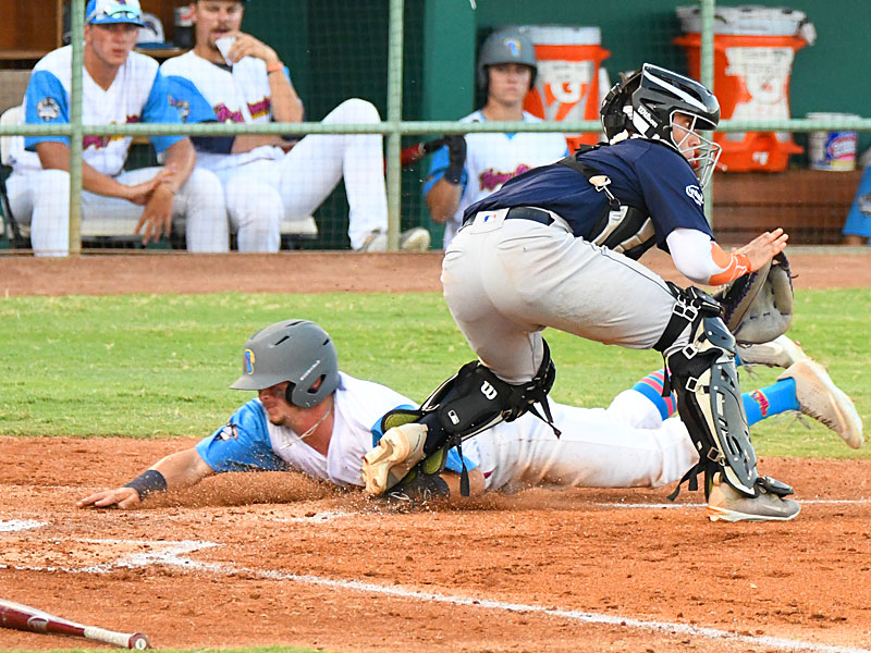 Jordan Thompson slides safely in to home to score in the third inning Sunday in the Flying Chanclas' victory over the Round Rock Hairy Men at Wolff Stadium. - photo by Joe Alexander