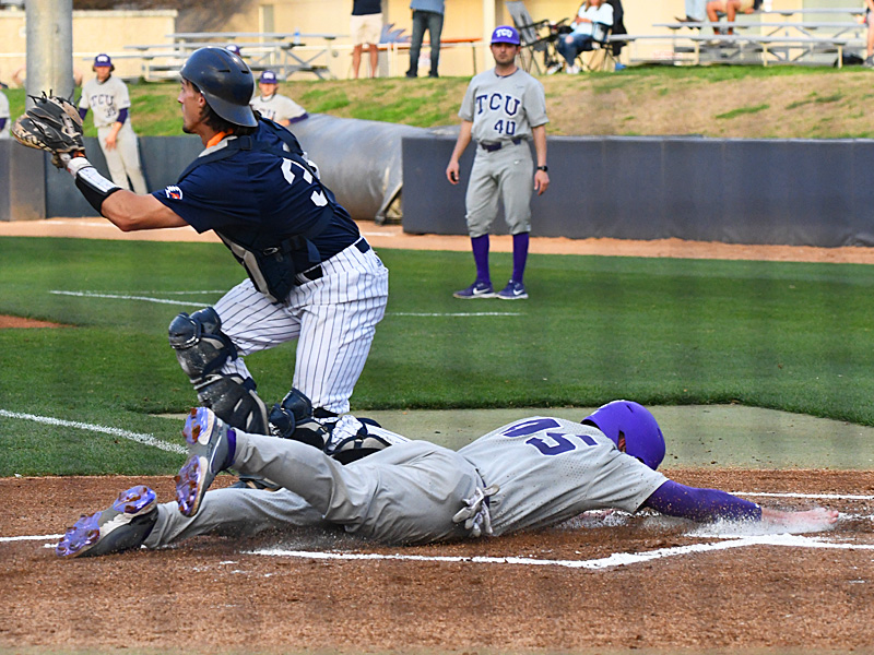 TCU's Luke Boyers scores in the top of the first inning against UTSA on Wednesday, March 10, 2021, at Roadrunner Field. - photo by Joe Alexander