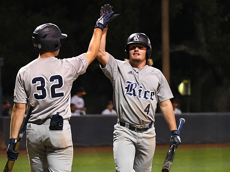 Rice's Justin Dunlap (right) celebrates after scoring the go-ahead run against UTSA in the sixth inning on Friday at Roadrunner Field. - photo by Joe Alexander