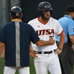 Griffin Paxton talks things over with UTSA coach Pat Hallmark at third base moments before scoring to tie the game in the bottom of the seventh inning of Saturday's second game against Middle Tennessee. - photo by Joe Alexander