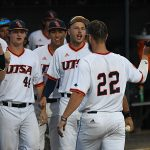 Griffin Paxton (22) is greeted in the UTSA dugout after scoring the run to tie the game in the bottom of the seventh inning of Saturday's second game against Middle Tennessee. - photo by Joe Alexander