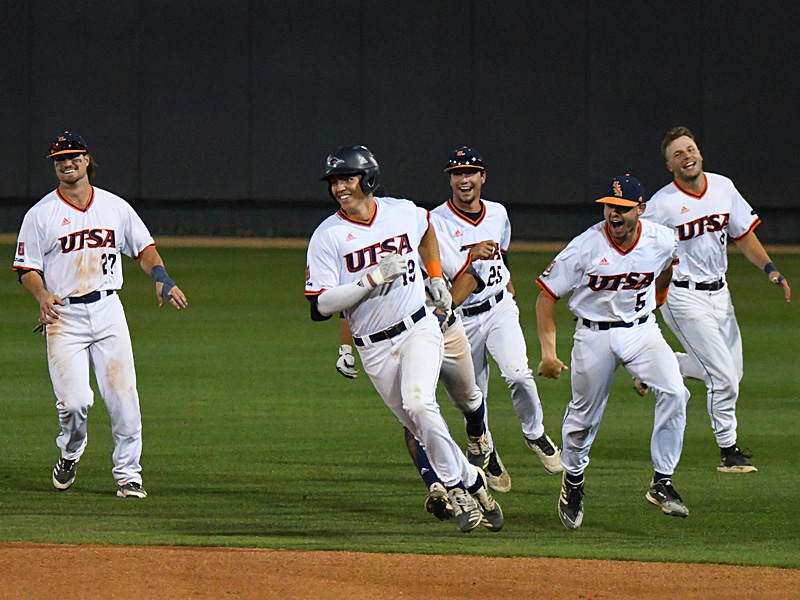 UTSA's Leyton Barry (19) celebrates with teammates after he bunted in the winning run in extra innings of Saturday's second game against Middle Tennessee. - photo by Joe Alexander