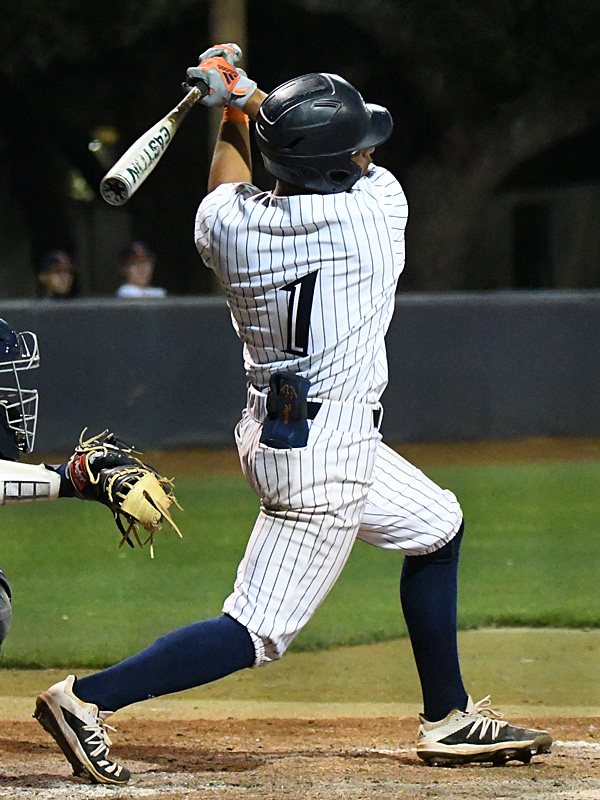 UTSA's Jonathan Tapia hits a two-run double in the fourth inning against Rice on Friday, April 24, 2021, at Roadrunner Field. - photo by Joe Alexander