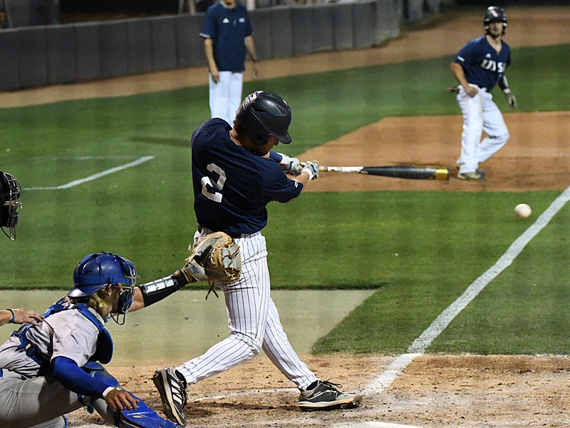 UTSA's Joshua Lamb smacks a hit that scores Nick Thornquist with the go-ahead run in the bottom of the eighth inning.
