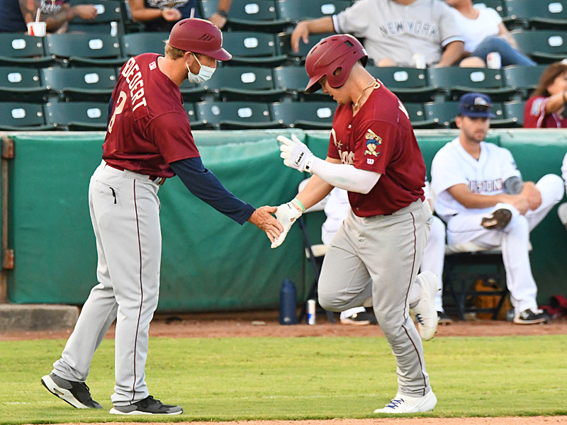 The Frisco RoughRiders' Steele Walker is congratulated by Frisco manager and third base coach Jared Goedert as Walker rounds the bases on his fourth-inning home run against the San Antonio Missions on Friday at Wolff Stadium. - photo by Joe Alexander