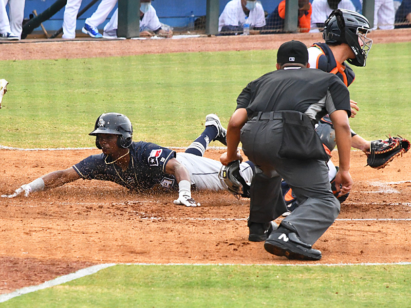 Esteury Ruiz slides into home with the San Antonio Missions' second run of the game in Tuesday's season-opening victory over the Corpus Christi Hooks. - photo by Joe Alexander