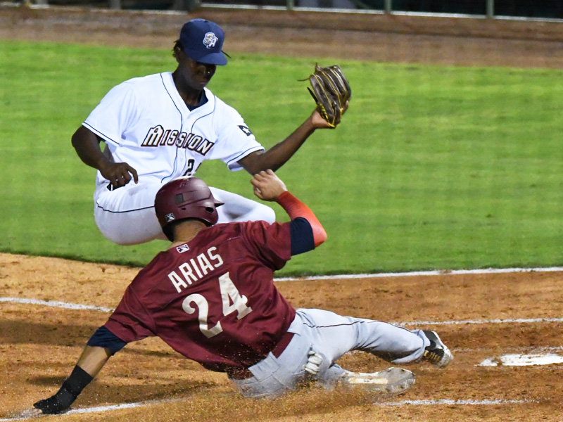 The Frisco RoughRiders' Diosbel Arias slides safely into home in front of San Antonio Missions pitcher Henry Henry to score the only run of the game on Tuesday, May 18, 2021, at Wolff Stadium. - photo by Joe Alexander