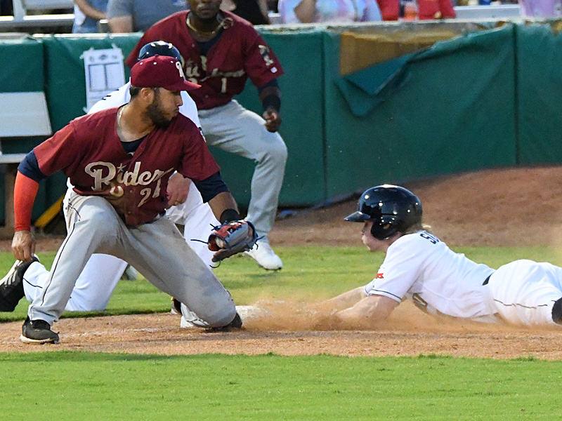 The San Antonio Missions' Jack Suwinski slides into third base ahead of the tag with a fifth-inning triple against the Frisco RoughRiders on Friday at Wolff Stadium. - photo by Joe Alexander