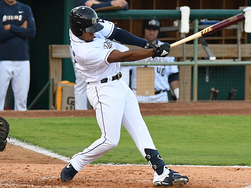 Jose Azocar drives in Michael Curry with the Missions' first run in the bottom of the second inning Wednesday at Wolff Stadium. - photo by Joe Alexander