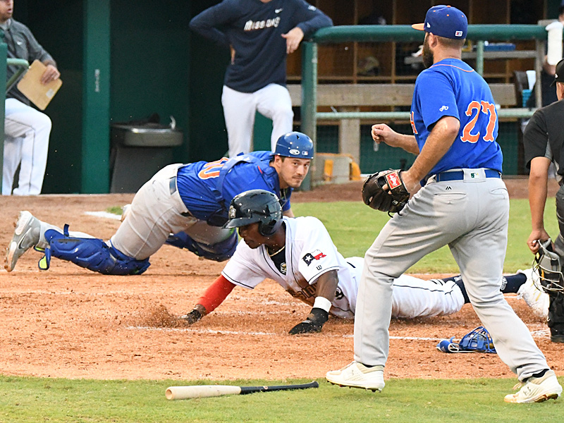 The San Antonio Missions' Esteury Ruiz is safe at home to score on a single by Chandler Seagle in the third inning. The Missions beat the Midland RockHounds 4-2 Tuesday night at Wolff Stadium. - photo by Joe Alexander