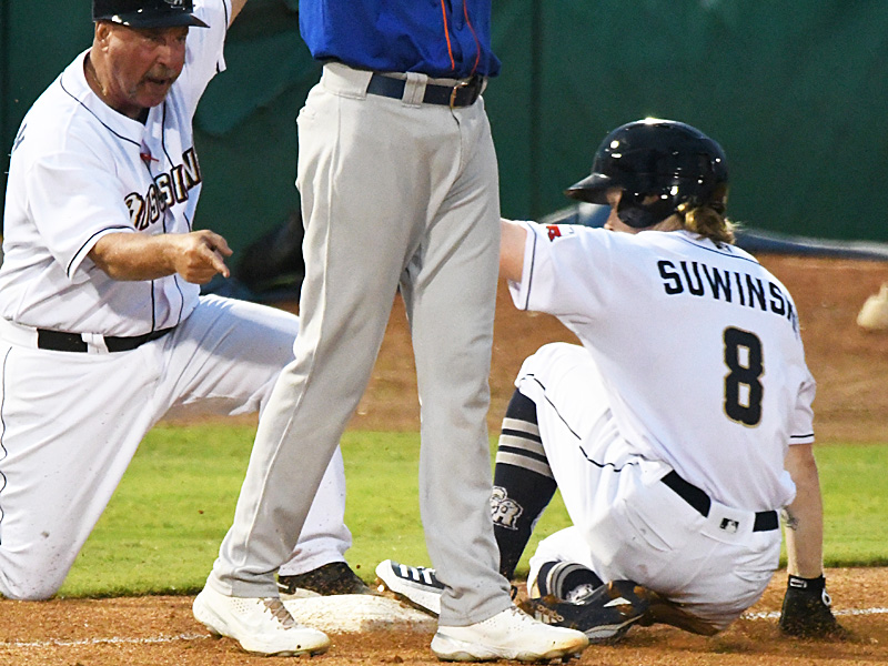 The San Antonio Missions' Jack Suwinski slides into third with a triple in front of Missions manager Phillip Wellman. The Missions beat the Midland RockHounds 4-2 Tuesday night at Wolff Stadium. - photo by Joe Alexander