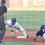 San Antonio Missions shortstop CJ Abrams tries to tag out Northwest Arkansas' Clay Dungan at second base. The Missions lost to the Northwest Arkansas Naturals 3-2 Wednesday at Wolff Stadium. - photo by Joe Alexander