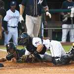 San Antonio Missions catcher Chandler Seagle tags out Northwest Arkansas' MJ Melendez trying to score on a double steal attempt in the fifth inning. The Missions lost to the Northwest Arkansas Naturals 3-2 Wednesday at Wolff Stadium. - photo by Joe Alexander