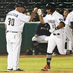 The San Antonio Missions' Yorman Rodriguez is congratulated by manager Phillips Wellman on the way home after hitting an eighth-inning home run. The Missions lost to the Northwest Arkansas Naturals 3-2 Wednesday at Wolff Stadium. - photo by Joe Alexander
