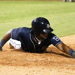 Eguy Rosario slides into home for the Missions' final run on Friday at Wolff Stadium. - photo by Joe Alexander