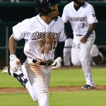 Jose Azocar (left) runs to first base with a hit as Allen Cordoba (background right) heads home with the game-winning run with two outs in the bottom of the 10th inning. The San Antonio Missions beat the Amarillo Sod Poodles 5-4 on Tuesday at Wolff Stadium. - photo by Joe Alexander