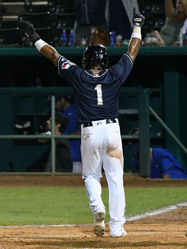 Eguy Rosario celebrates as he scores the winning run in the San Antonio Missions' victory over the Amarillo Sod Poodles on Wednesday night at Wolff Stadium. - photo by Joe Alexander